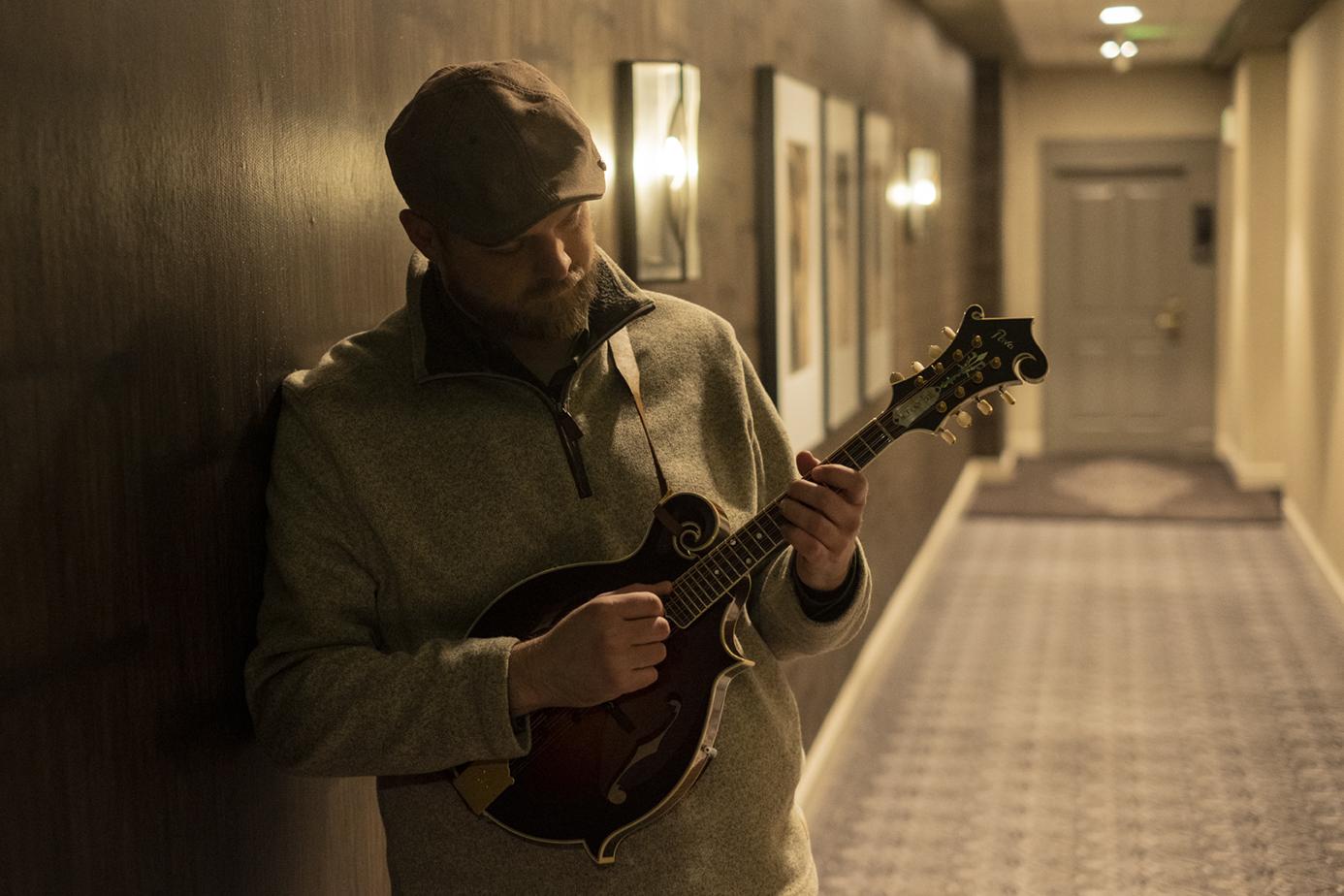 Nate Lee with mandolin in hallway - photo credit Scott Simontacchi