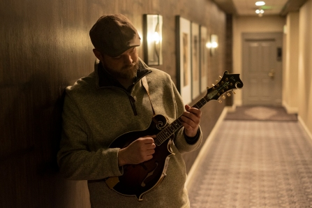 Nate Lee with mandolin in hallway - photo credit Scott Simontacchi